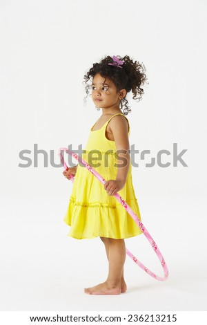 Girl with toy hoop - stock photo