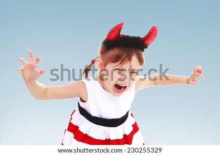 Girl with toy red horns on his head, white background.charming little girl - stock photo