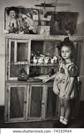Girl with toys, old photos - stock photo