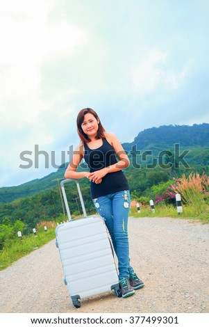 Girl with travel bag traveler at the road to nature, Travel or relax concept.