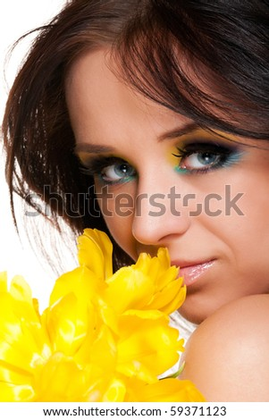 girl with tulip on white background - stock photo