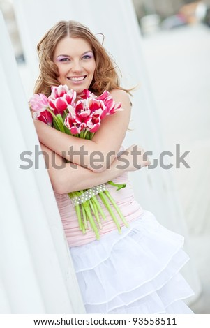 Girl with tulips - stock photo