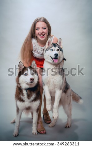 Girl with two dogs Siberian husky - stock photo