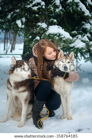 Girl with two husky - stock photo