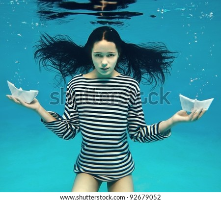 Girl with two paper boats - stock photo