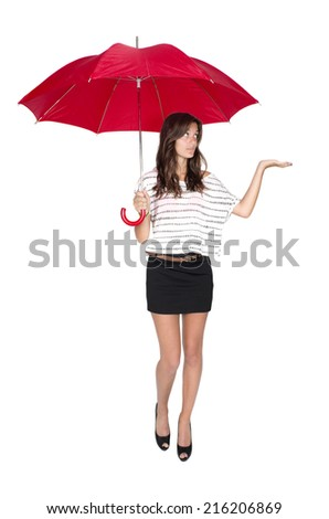 girl with umbrella checking for rain - stock photo