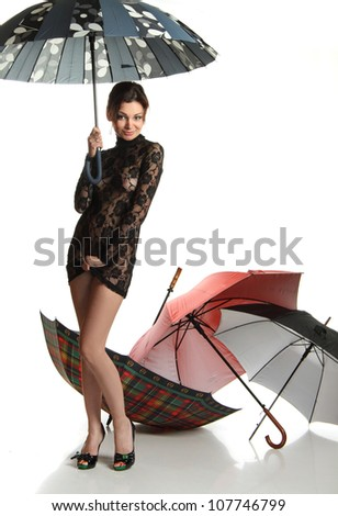 Girl with umbrella in a happy dance - stock photo