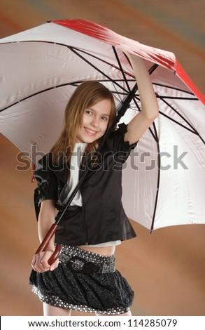 Girl with umbrella in a happy dance