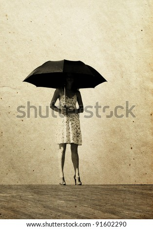 girl with umbrella. Photo in old color image style. - stock photo