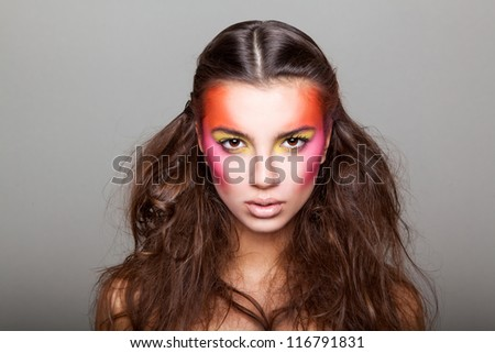 girl with unusual make-up on gray gradient background - stock photo