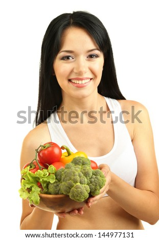 Girl with vegetables isolated on white