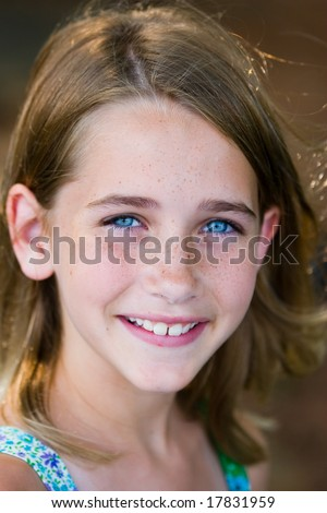 Girl with very blue eyes - stock photo