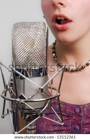 Girl with vintage microphone - stock photo