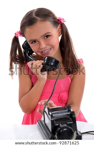 girl with vintage phone - stock photo