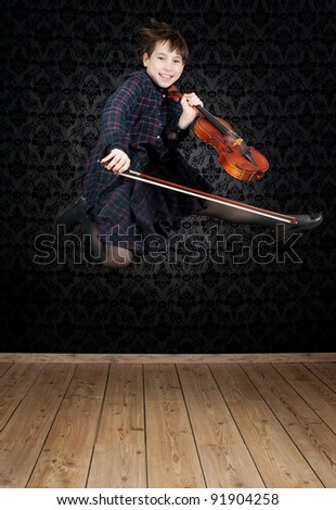 girl with violin jumping - stock photo