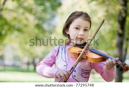 girl with violin outdoor - stock photo