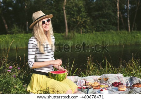 girl with watermelon on picnic