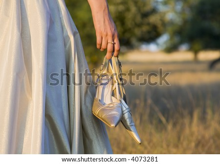 girl with wedding shoes in her hand