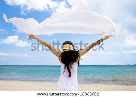 girl with white cloth enjoying seascape - stock photo
