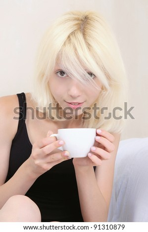 Girl with white cup - stock photo