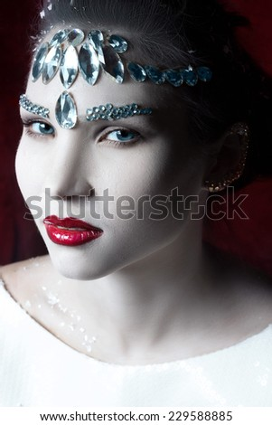 girl with white leather adorned with rhinestones