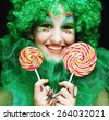 Girl with with creative make-up holds lollipop. Doll style.  - stock