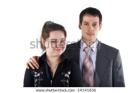 Girl with young man in suit isolated on white