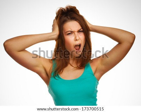 girl woman screaming wild hair opened her mouth prislanila hands to his head emotion gray large - stock photo