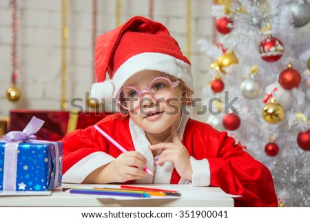 Girl wondering drawing card for Christmas - stock photo