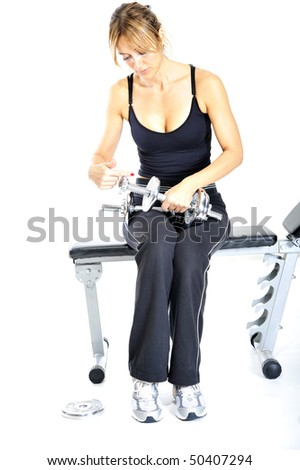 Girl working out towards white background
