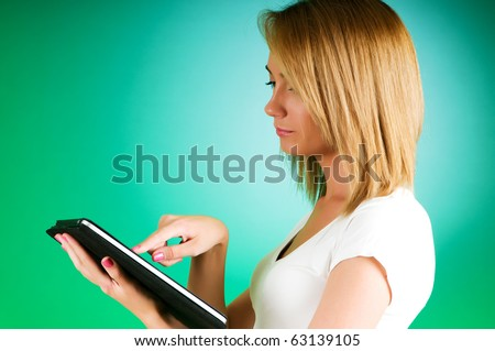 Girl working with the portable tablet computer - stock photo