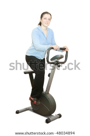 Girl workout on stationary bicycle. Isolated on white