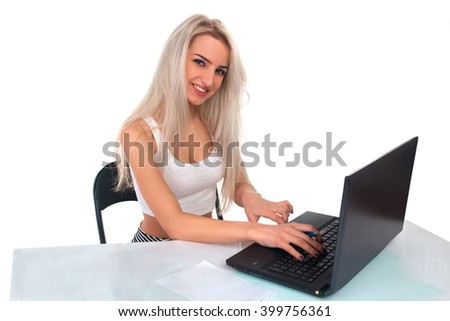 Girl works at a laptop on a white background