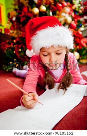 Girl writing a Christmas letter for Santa - stock photo
