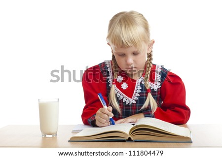 girl writing and a glass of milk
