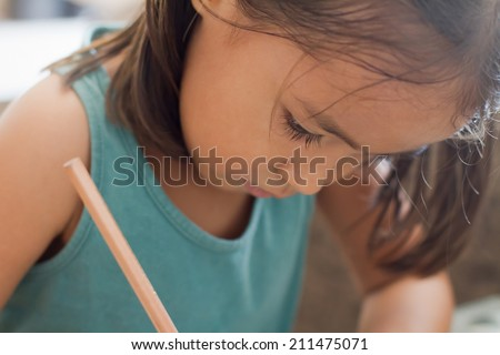 girl writing, drawing with pencil - stock photo