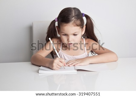 Girl writing in a notebook - stock photo