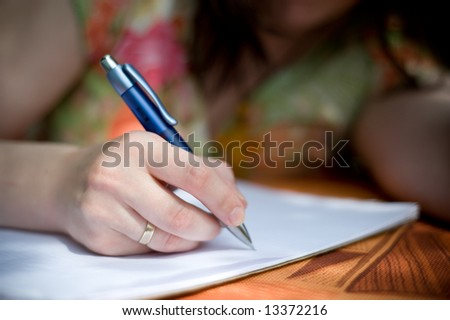Girl writing in exercise book - stock photo