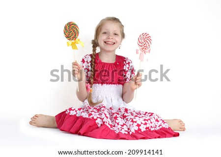 Girl 8 year old  with candy sweet on white background