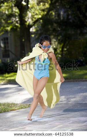 Girl, 7 years, running in homemade superhero costume - stock photo