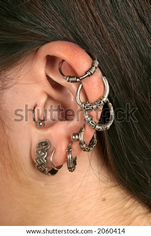 girl, young woman with ear-rings -close up - stock photo