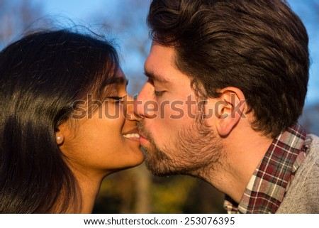 Girlfriend and Boyfriend  in love kissing outside - stock photo