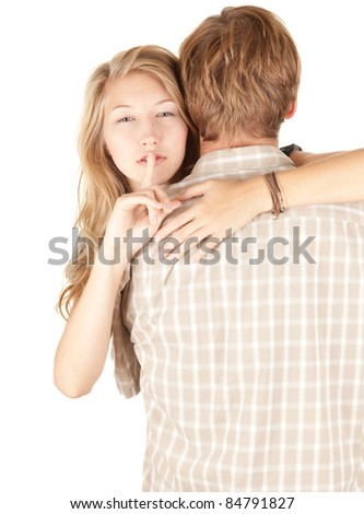 girlfriend hugging man and making silence gesture - stock photo