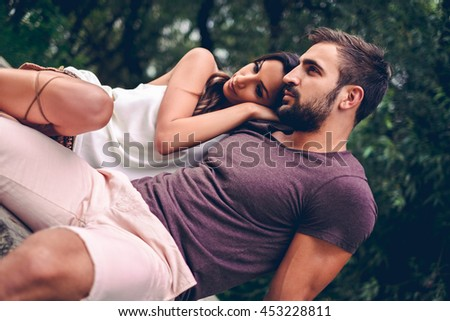 Girlfriend leaning on her boyfriend in the nature - stock photo