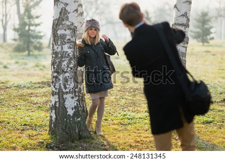 Girlfriend poses her boyfriend for a photo shoot.