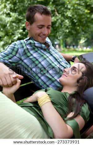 Girlfriend resting head on boyfriend's lap - stock photo