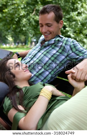 Girlfriend resting head on boyfriend's lap - stock photo