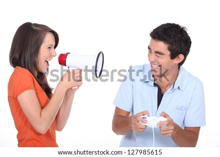 Girlfriend telling her boyfriend to stop playing video games - stock photo