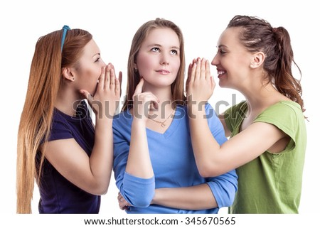 Girlfriends and Friendship Concept. Three Young caucasian Girlfriends Sharing Their Secrets Whispering to Ears.Isolated Over White Background - stock photo