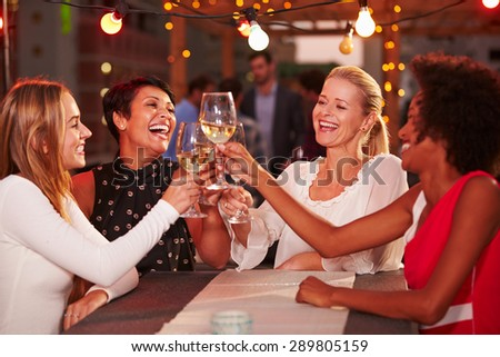 Girlfriends at rooftop party - stock photo
